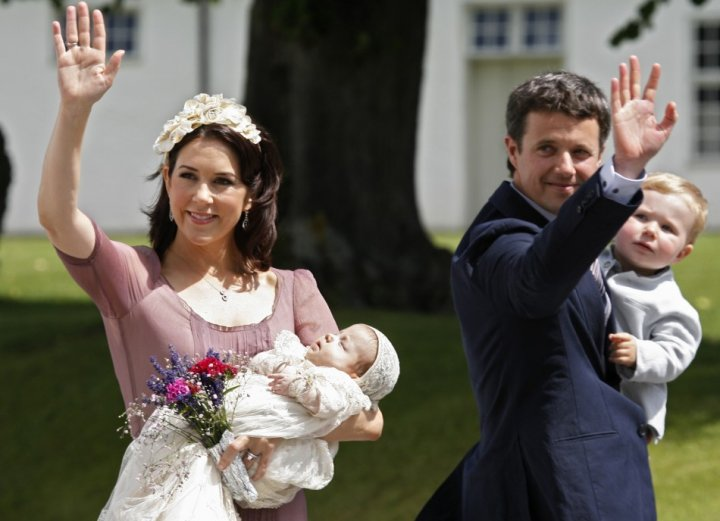 Denmark's Crown Princess Mary (L), holding Princess Isabella Henrietta Ingrid Margrethe and Crown Prince Frederik, holding Prince Christian, wave to well wishers following the christening of the new princess in Fredensborg in July 2007 photo. (Photo:
