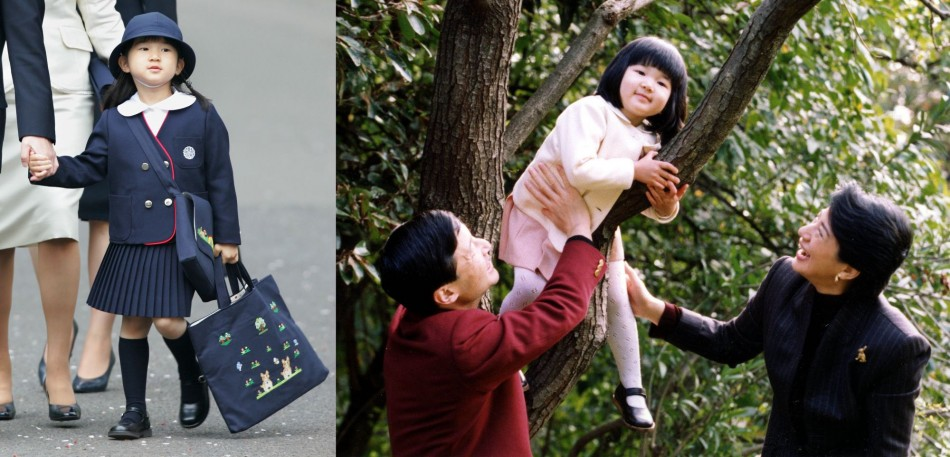 Japanese Princess Aiko plays on a tree as her father Crown Prince Naruhito and mother Crown Princess Masako watch in the garden of their residence, Togu Palace, in Tokyo on 17, November, 2004. Aiko is the only child of Japan's imperial heir Crown Prince N