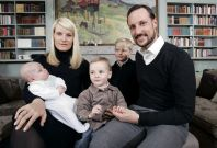 Norwegian Crown Prince Haakon and Crown Princess Mette-Marit pose with their family in their home at Skaugum, near Oslo in this March 2006 photo. Picture shows (left to right) the young Prince Sverre Magnus, Crown Princess Mette-Marit, Princess Alexandra,