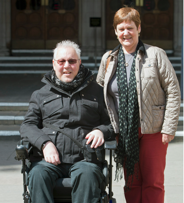 Pro-euthanasia campaigner Paul Lamb (L) poses for photographs with Jane Nicholson as he leaves the High Court in London in May (Photo: Reuters)