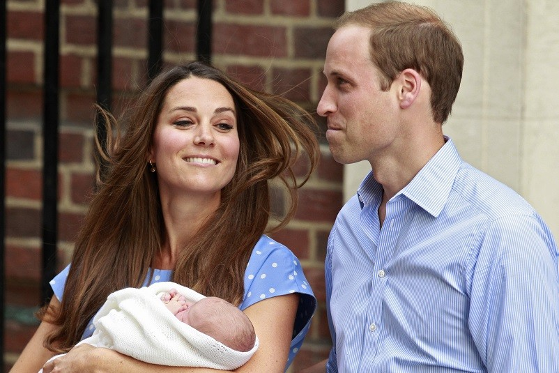 Prince, Prince and Princess? Newborn George with dad William and Kate (l)