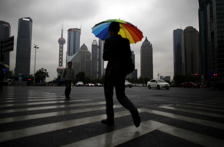A businessman walks with an umbrella