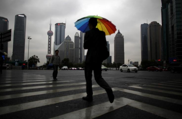 A businessman walks with an umbrella