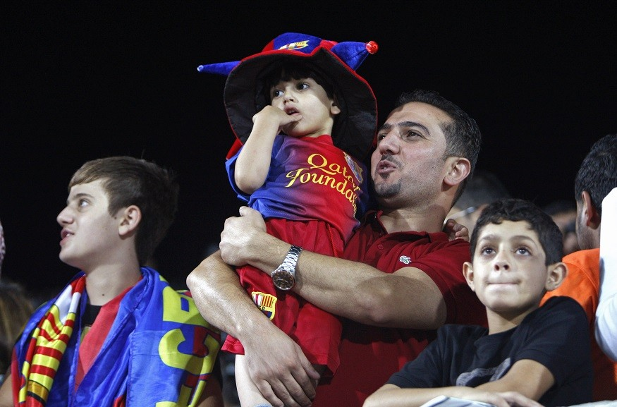 Swathes of youngsters clad in Barcelona shirts greeted the players in Dura