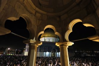 Palestinian worshipers pray in front of the Dome of the Rock, in the Al Aqsa Mosque compound in Jerusalem early August 4, 2013, during Lailat-Al-Qadr, or Night of Power, in which the Muslim holy book of Quran was revealed to Prophet Mohammad by Allah. (Ph