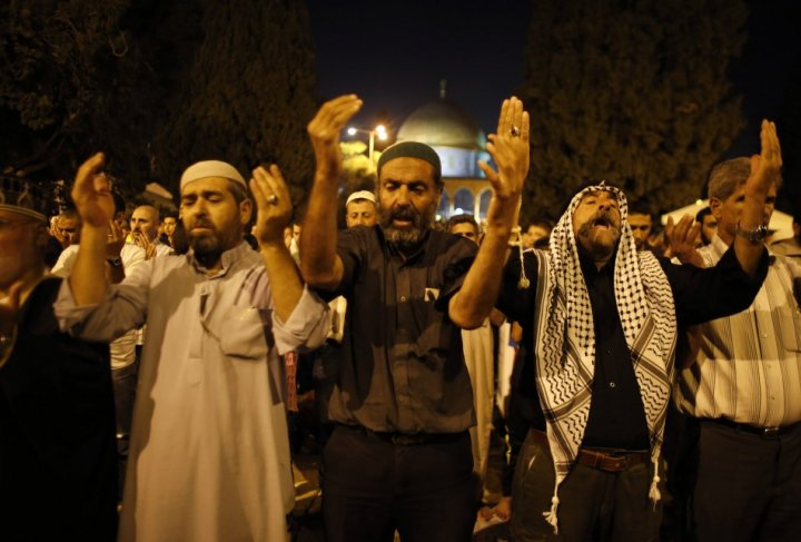 Observers of Lailat al-Qadr pray in front of the Dome of the Rock on the compound known to Muslims as Noble Sanctuary and to Jews as Temple Mount in Jerusalem's Old City on 4 August.
