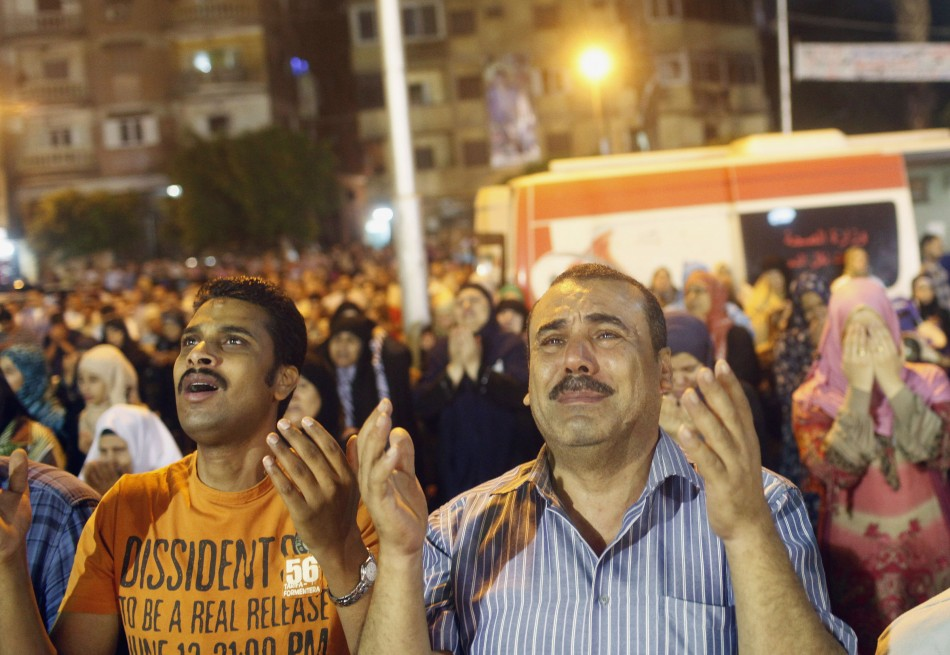 People perform Ramadan night prayers celebrating Lailat-Al -Qadr, or Night of Power, outside of a mosque in Cairo, August 4, 2013. (Photo: REUTERS/Asmaa Waguih)