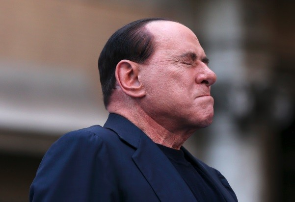 Former Italian Prime Minister Silvio Berlusconi closes his eyes in a gesture to supporters during a rally to protest his tax fraud conviction, outside his palace in central Rome August 4 (Photo: Reuters)