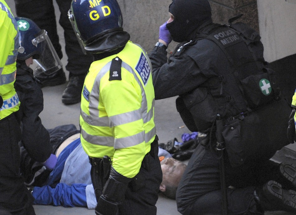 Ian Tomlinson was struck by Simon Harwood as he made his way home through the G20 protests in London (Reuters)