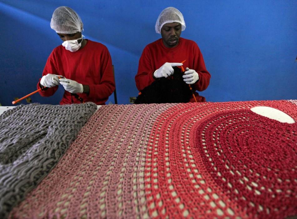 Prisoners knit clothing for Brazilian fashion designer Raquel Guimaraes in the Arisvaldo de Campos Pires maximum security penitentiary in Juiz de Fora, about 160 kilometres north of Rio de Janeiro. (Photo: REUTERS/Paulo Whitaker)