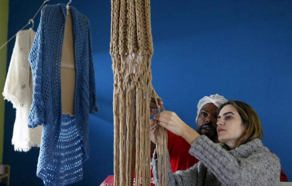 Guimaraes supervises a prisoner knitting for her in the Arisvaldo de Campos Pires prison in Brazil. (Photo: REUTERS/Paulo Whitaker)