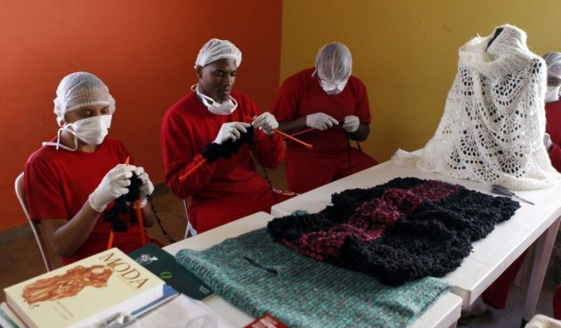 Prisoners knit clothing Guimaraes in exchange of pay and reduced sentence. (Photo: REUTERS/Paulo Whitaker)