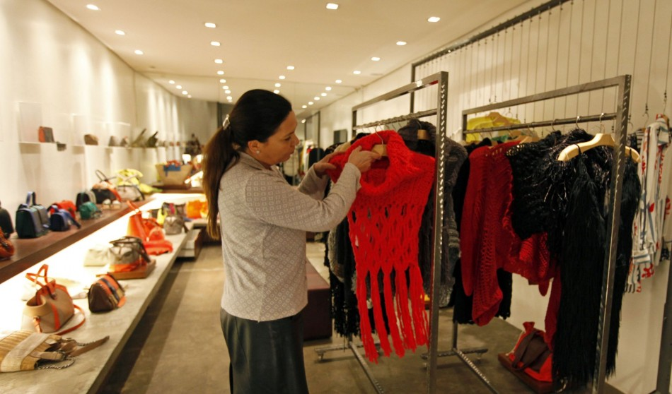 A saleswoman arranges clothing knitted for Brazilian fashion designer Raquel Guimaraes by prisoners of the Arisvaldo de Campos Pires. (Photo: REUTERS/Paulo Whitaker)