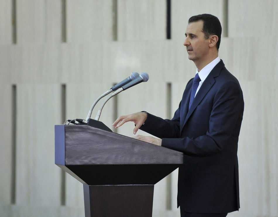 Syria's President Bashar al-Assad delivers a speech while attending an Iftar, or breaking fast session, during the Muslim month of Ramadan in Damascus