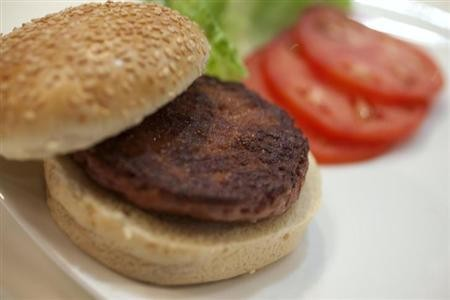 The world's first lab-grown beef burger is seen after it was cooked at a launch event in west London August 5, 2013. The in-vitro burger, cultured from cattle stem cells, the first example of what its creator says could provide an answer to global fo