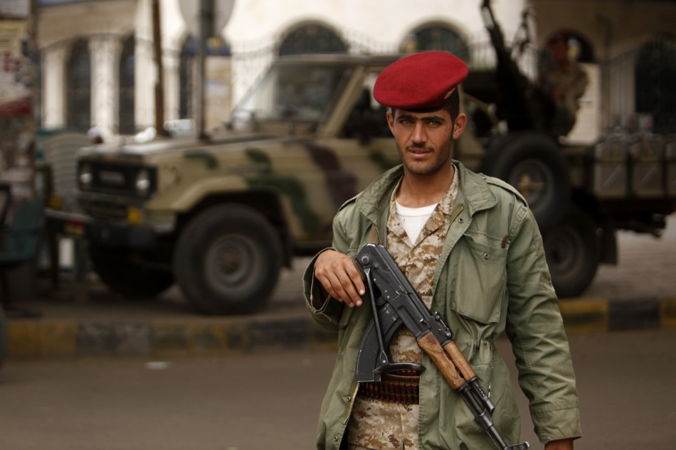 An army trooper looks on, while manning a checkpoint in Sanaa