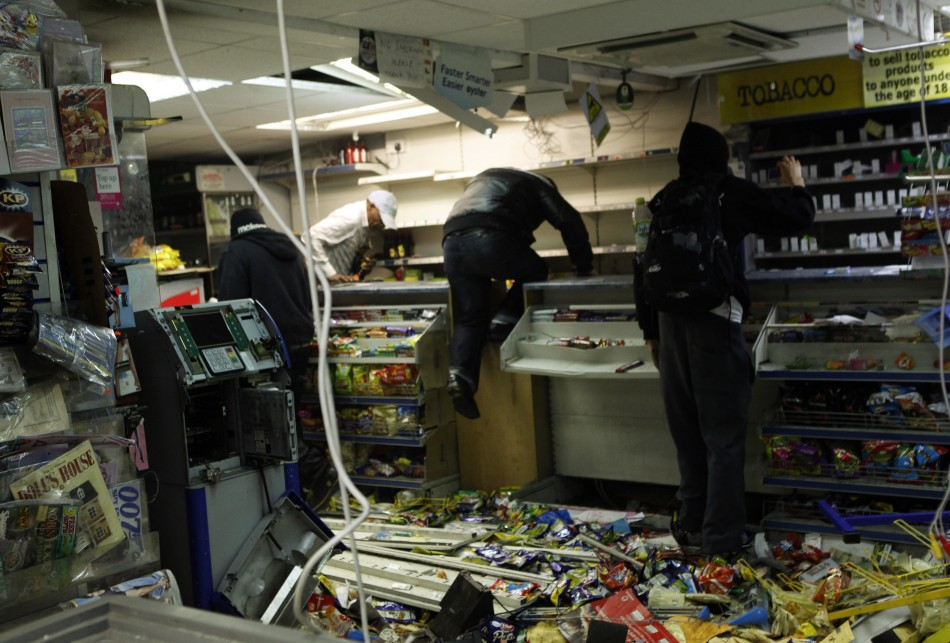 Looters rampage through a convenience store in Hackney, east London August 8, 2011 (Photo: Reuters)