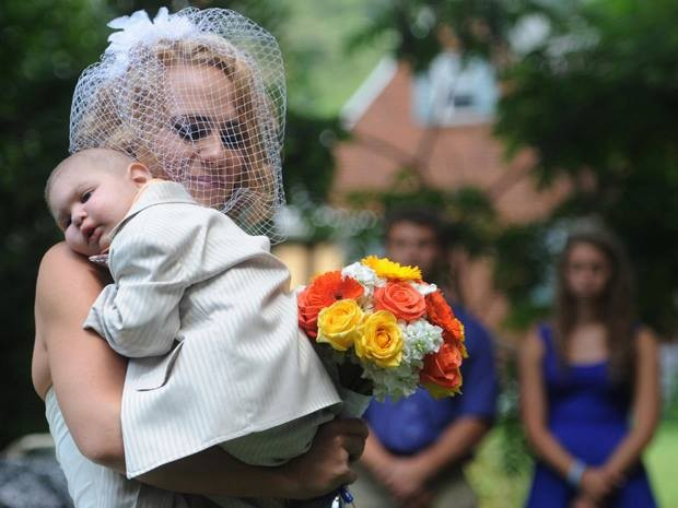Two-year-old Logan served as best man at his parents' wedding before dying in his mother's arms two days later. He had cancer. (Photo: Facebook)