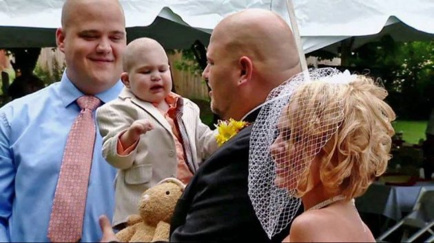 Happy for the last time: Logan with his parents on their wedding day in Jeannette, a suburb of Pittsburgh. (Photo: Facebook)