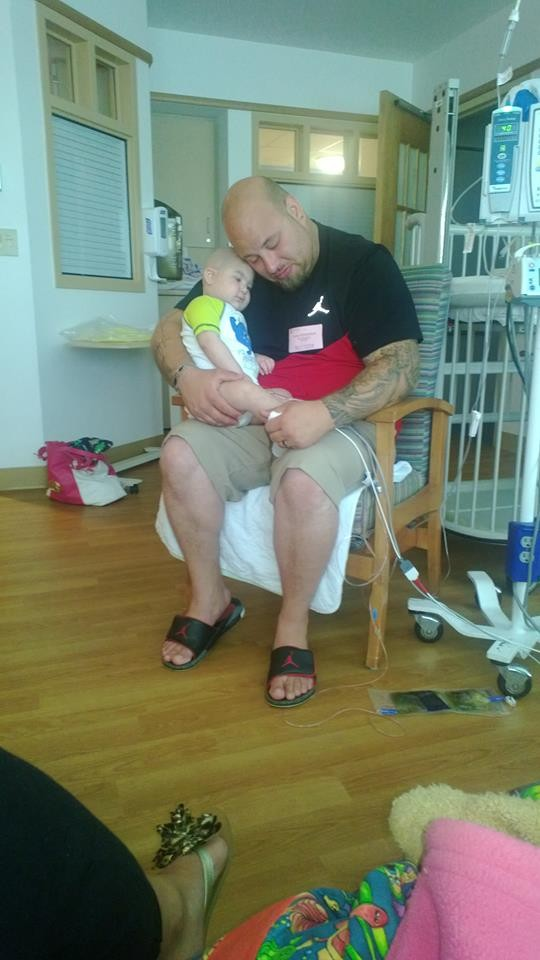 Logan, seen here with his father Sean, had to be with medical equipment always.  (Photo: Facebook)