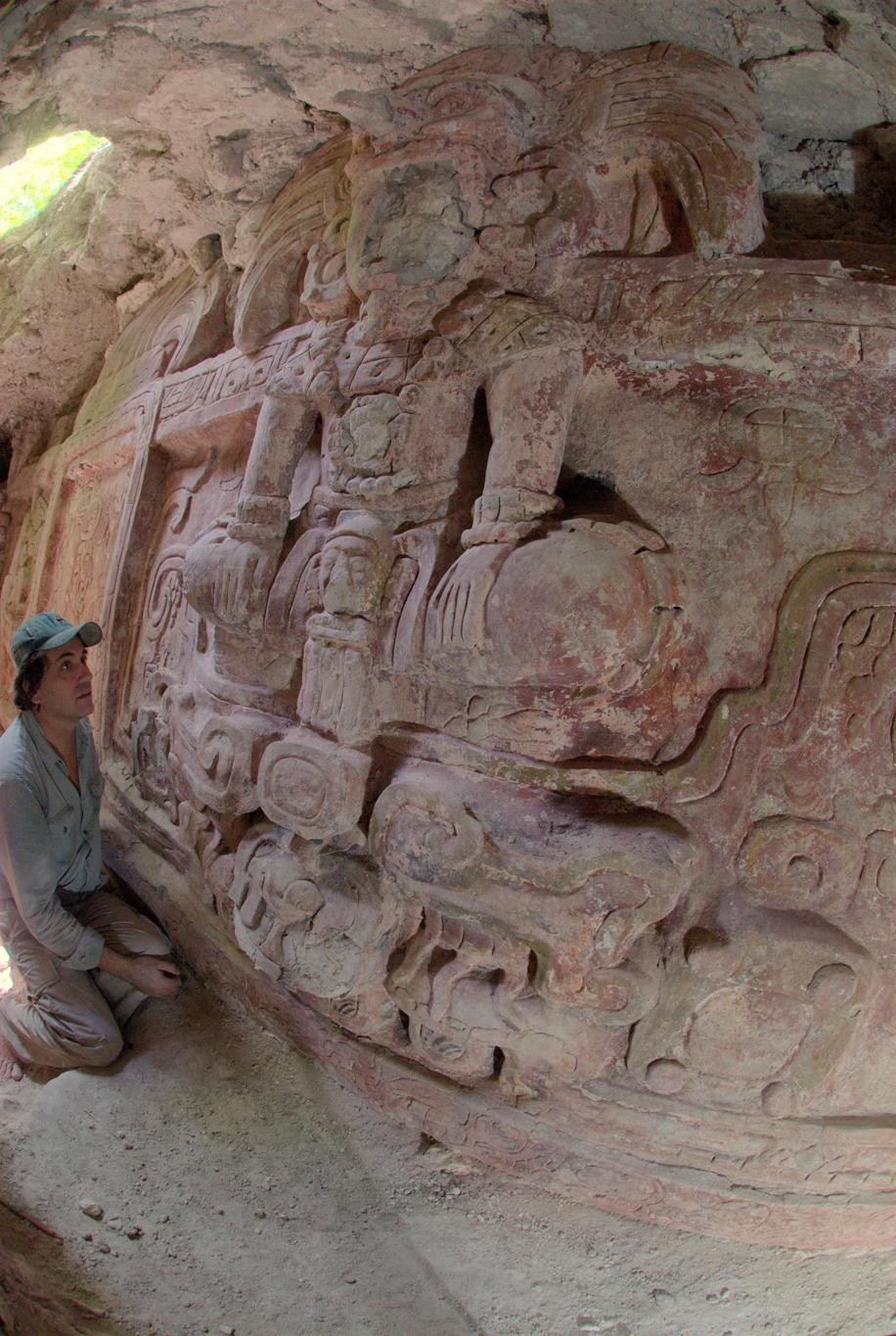 Francisco Estrada-Belli, who found the frieze, looks at it. (Photo: Estrada-Belli/© Holmul Archaeological Project)