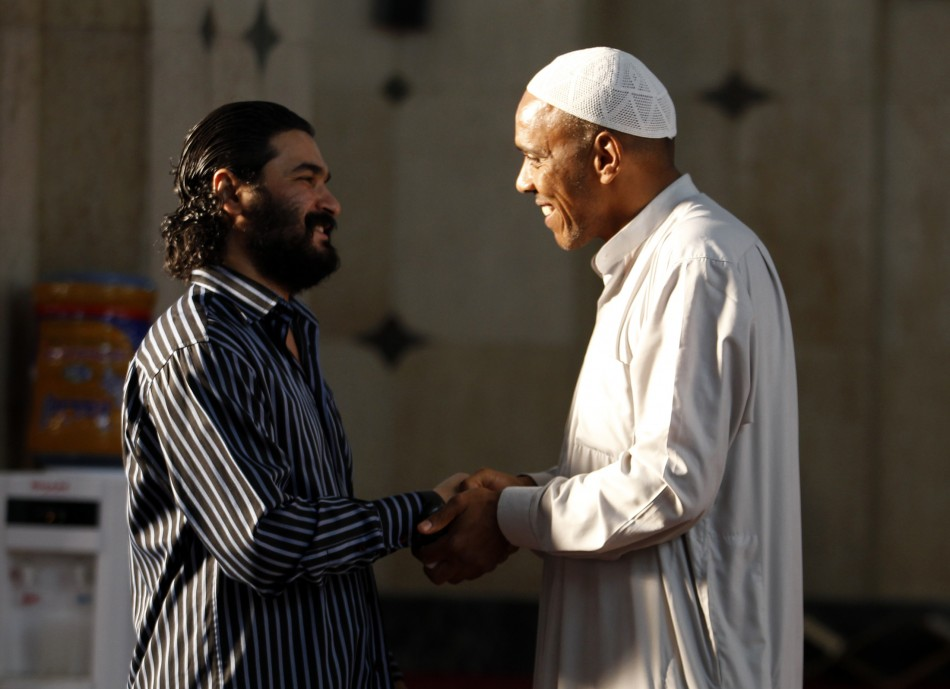Sunni worshippers exchange greetings after their Eid al-Fitr prayers to mark the end of the Muslim holy fasting month of Ramadan at a Sunni mosque in Baghdad, August 8, 2013.  (Photo: REUTERS/Thaier al-Sudani)