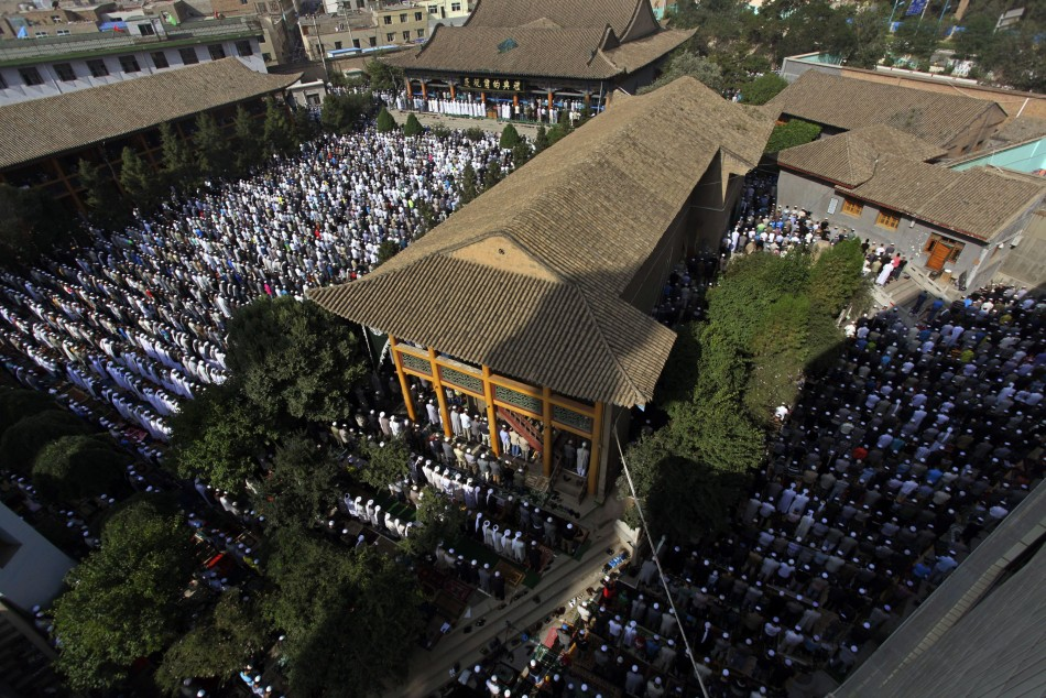 Muslims attend a massive prayer session at Dongguan Great Mosque during Eid al-Fitr, marking the end of Ramadan, in Xining, Qinghai province August 8, 2013. (Photo: REUTERS/Simon Zo)
