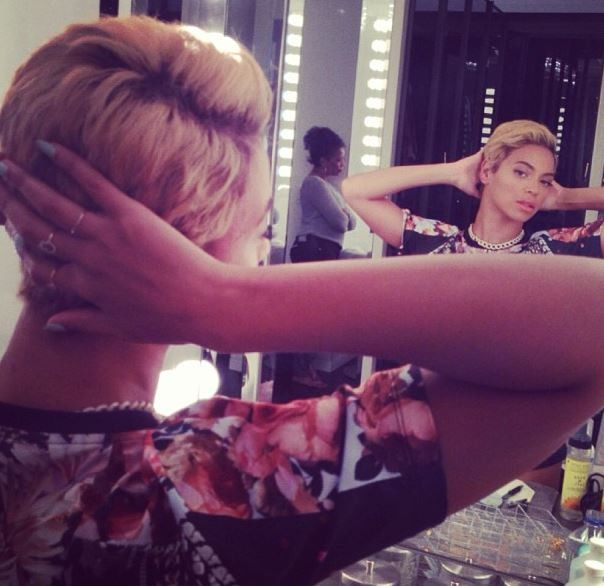 Beyonc posted a photo of herself looking in the mirror, admiring her new pixie cut