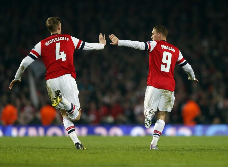 Lukas Podolski (R) and Per Mertesacker