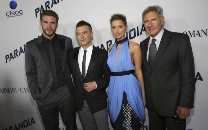 Director of the movie Robert Luketic (2nd L) poses with cast members Liam Hemsworth (L), Amber Heard and Harrison Ford (R) at the premiere of