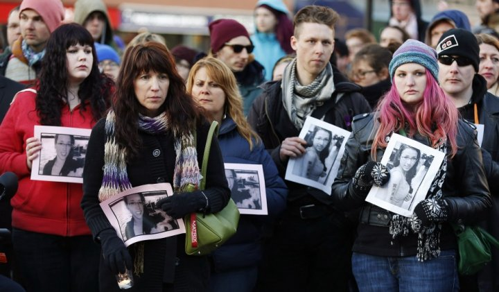 People hold photographs of 17-year-old Rehtaeh Parsons during a memorial vigil at Victoria Park in Halifax, Nova Scotia