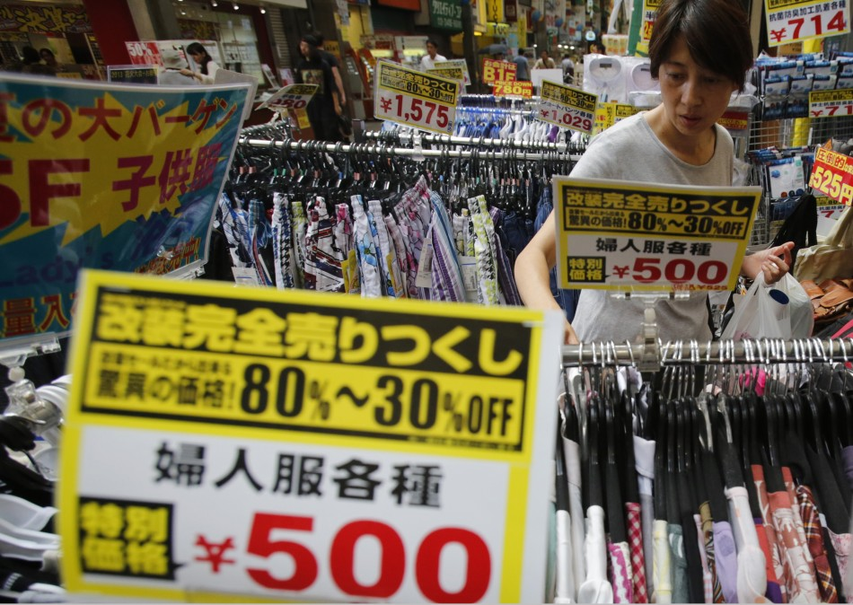 A woman looks at clothes at a local shopping street in Tokyo