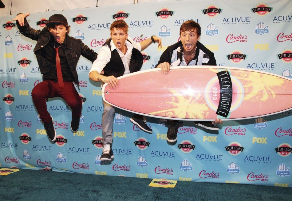 Members of the group Emblem3 leap in the air after winning the Choice Music Breakout Group at the Teen Choice Awards 2013. (Photo: Reuters)