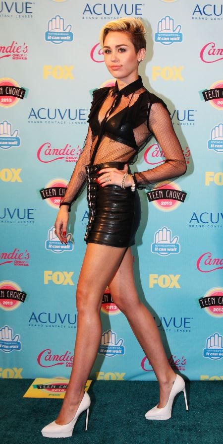 Actress and singer Miley Cyrus poses for photographers after being named this years' Candies' Choice Style Icon at the Teen Choice Awards at the Gibson amphitheatre in Universal City, California August 11, 2013.