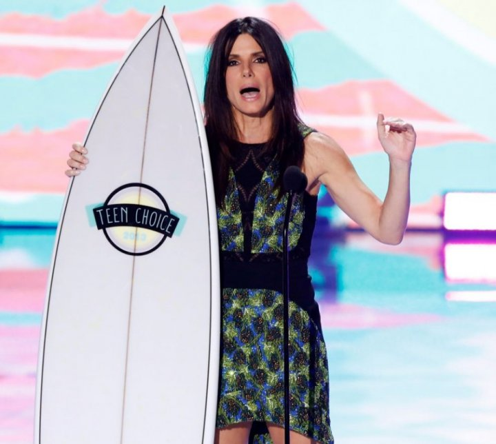Actress Sandra Bullock accepts the Choice Summer Movie Star: Female Award at the Teen Choice Awards at the Gibson amphitheatre in Universal City, California August 11, 2013.