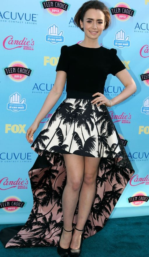English actress Lily Collins poses as she arrives at the Teen Choice Awards at the Gibson amphitheatre in Universal City, California August 11, 2013.