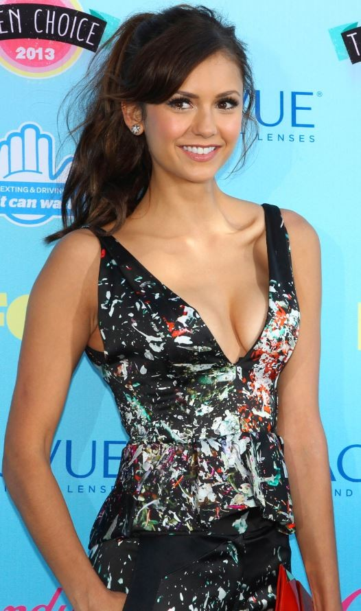 Actress Nina Dobrev poses at the Teen Choice Awards at the Gibson amphitheatre in Universal City, California, August 11, 2013.