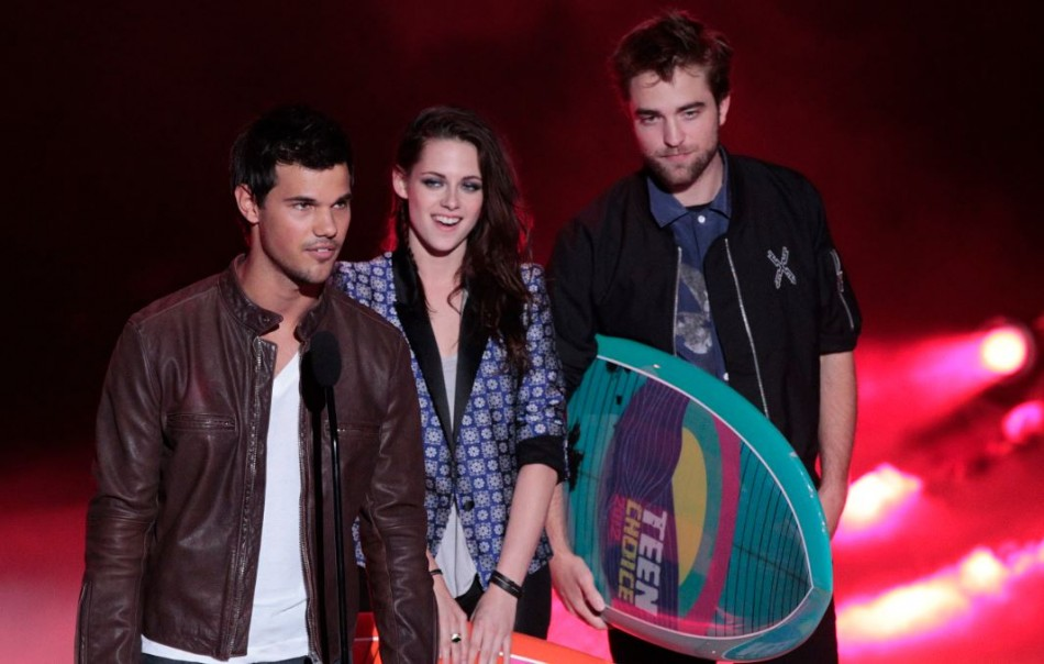 Robert Pattinson, Kristen Stewart and Taylor Lautner at the Teen Choice Awards 2012.