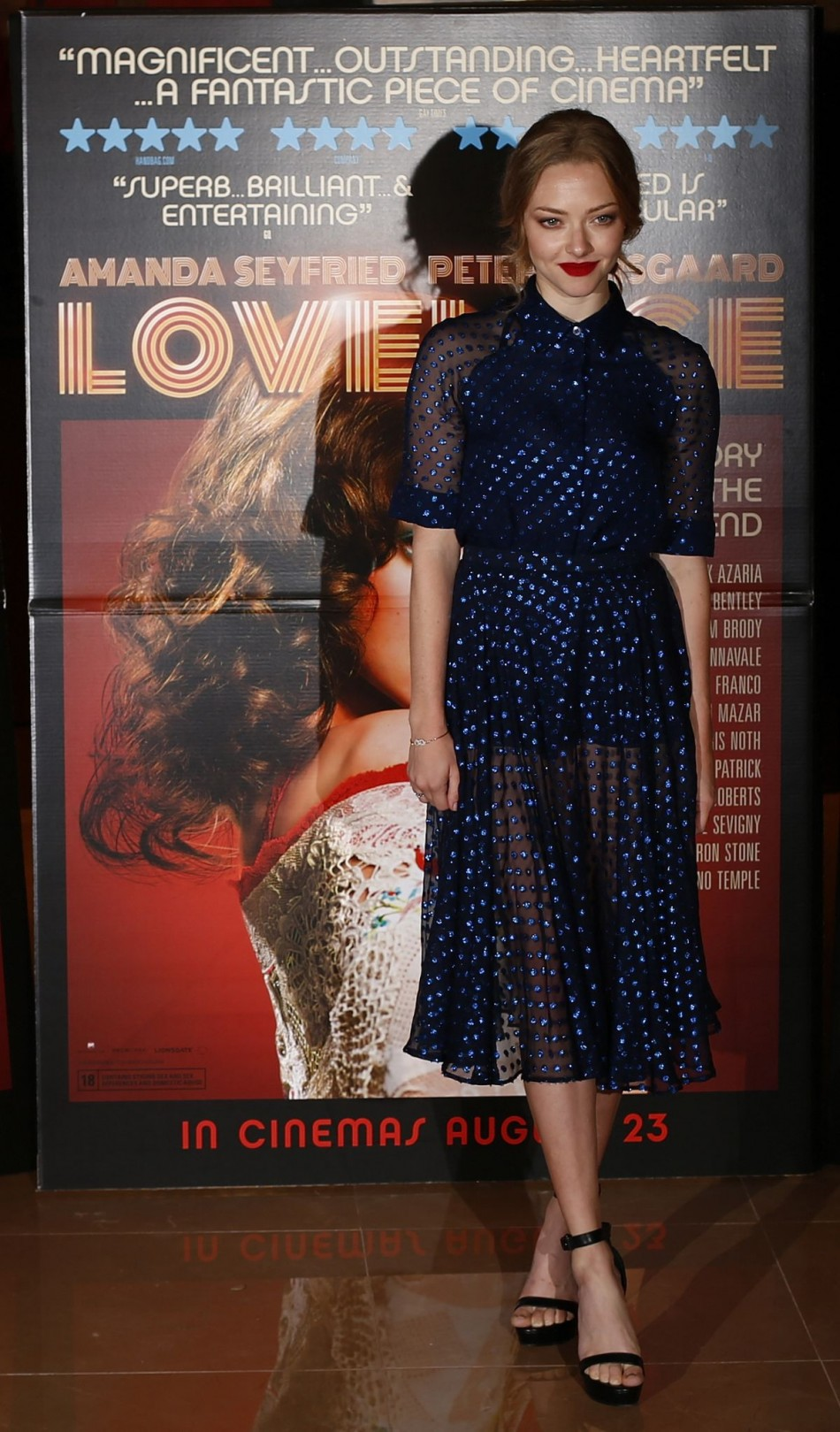 Amanda Seyfried wore a retro blue dress by Gucci to the UK premiere of Lovelace. (Photo: REUTERS/Andrew Winning)