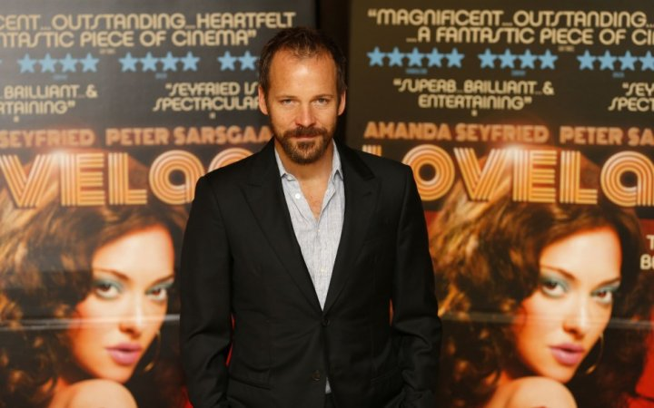 Co-actor Peter Saasgaard accompanied Amanda Seyfried to the screening of their film Lovelace in London. (Photo: REUTERS/Andrew Winning)