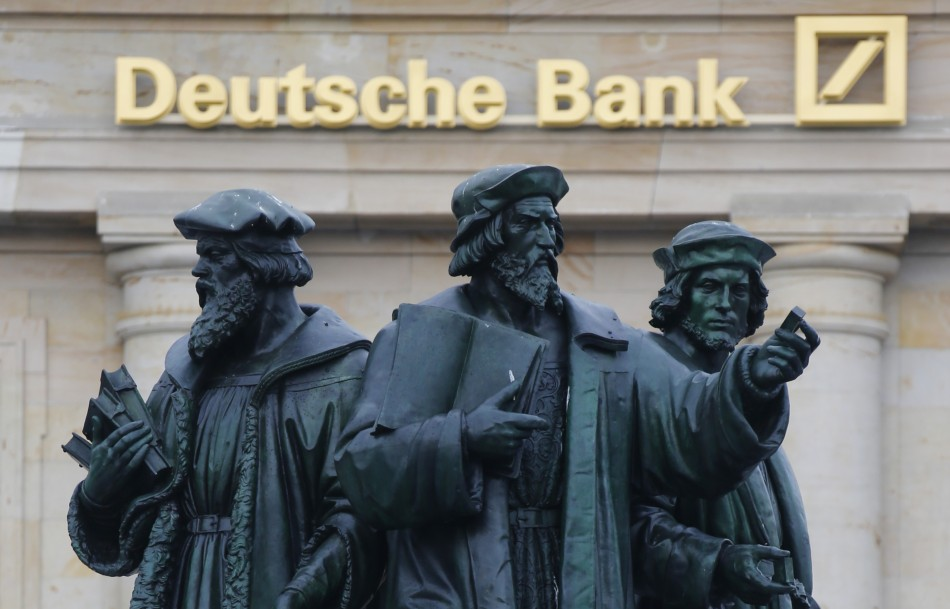 A statue is pictured in front of the former head quarters of Germany's largest business bank, Deutsche Bank in Frankfurt.