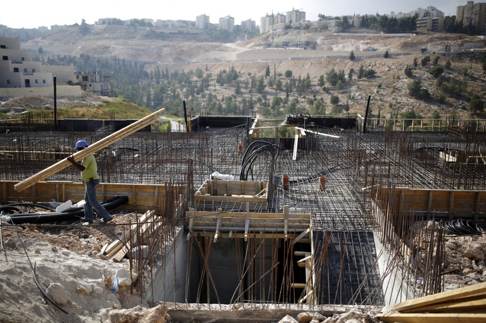 A labourer works on a construction site in Pisgat Zeev, an urban settlement in an area Israel annexed to Jerusalem