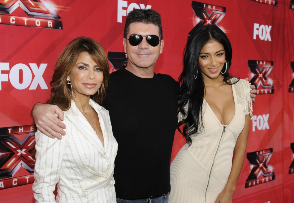 Simon Cowell : I Want to Eat Ice Cream Off Nicole Scherzinger's Body/Reuters