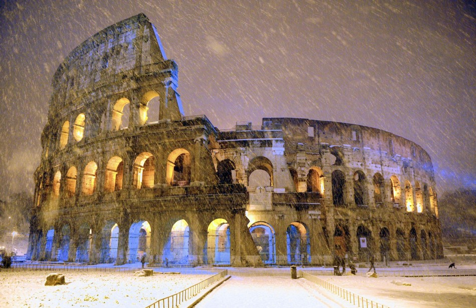 The ancient Colosseum is seen during an heavy snowfalls late in the night in Rome February 4, 2012. American archaeologists have excavated what they are calling a mini colosseum of the gladiator emperor Commodus. (Photo: REUTERS/Gabriele Forzano)