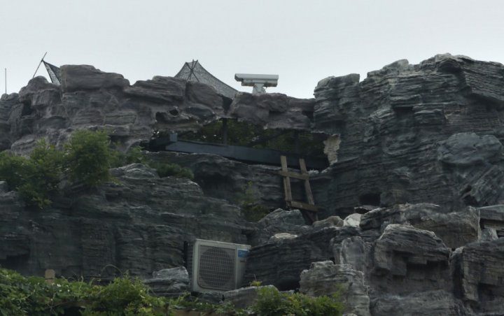 A surveillance camera is seen on the top of the rock villa. Residents in the building complained about the villa, fearing its weight may cause structural collapse. (Photo: Reuters)