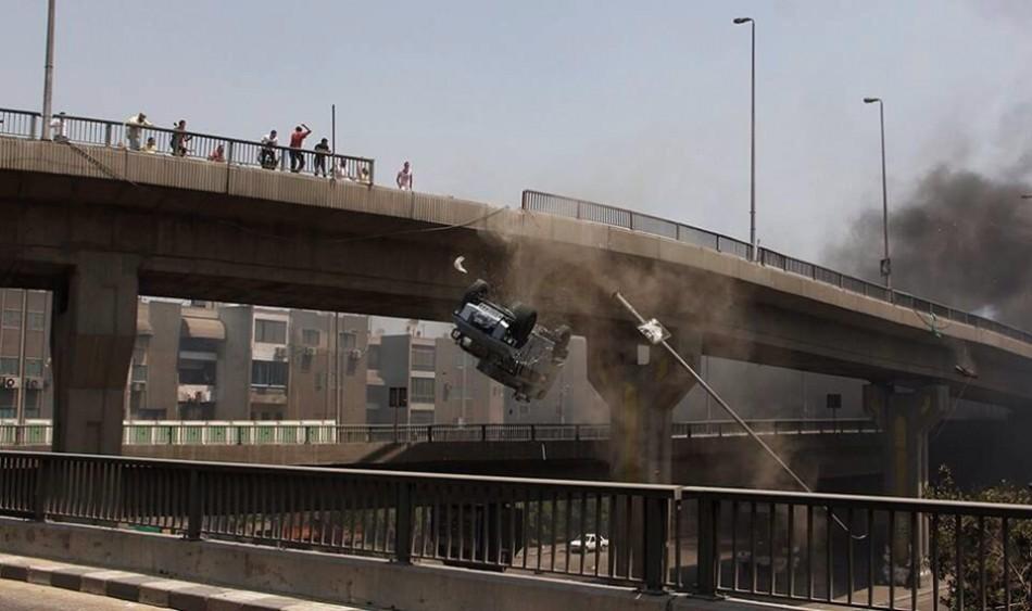 Police van pushed off Cairo bridge
