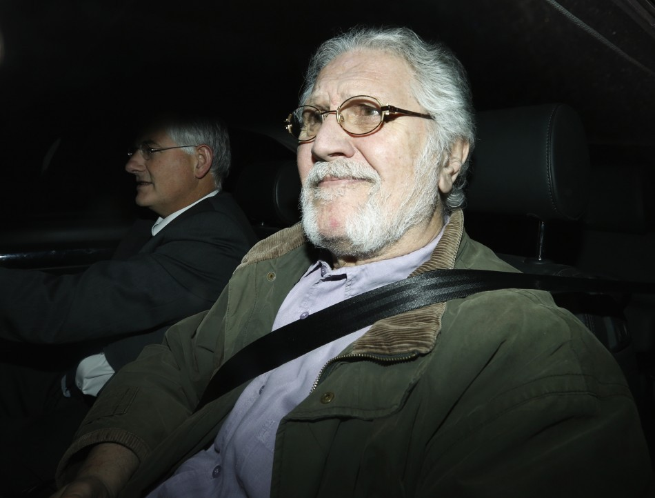 Dave Lee Travis returns to his house following his arrest in November (Reuters)