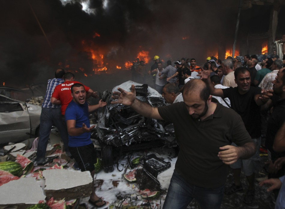 People shout for help at the site of an explosion in Beirut's southern suburbs,
