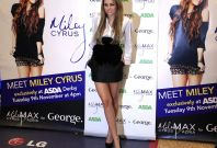 U.S. actress and singer Miley Cyrus poses for photographers as she launches a new clothing range for Asda, at a store in Derby, central England.