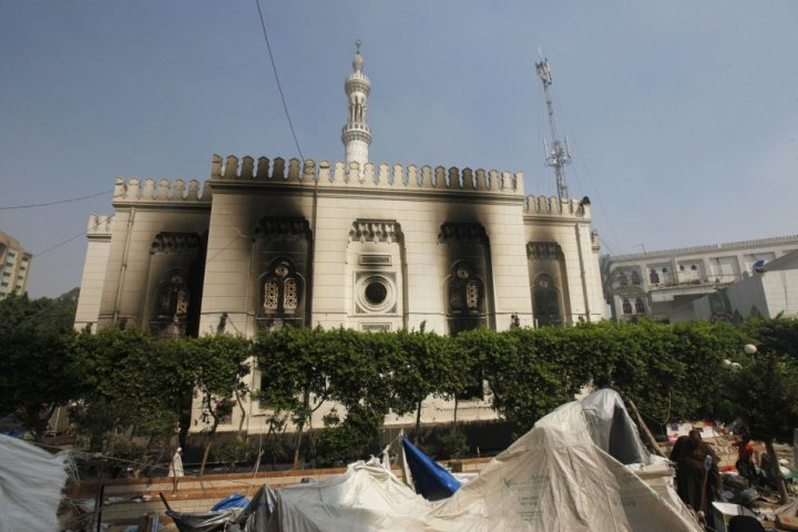 A general view of the burnt Rabaa Adawiya mosque on the morning after the clearing of the protest which was held around the mosque, in Cairo, August 15, 2013. (Photo: Reuters)